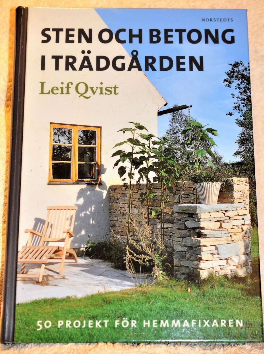bokomslag sten och betong i trädgården